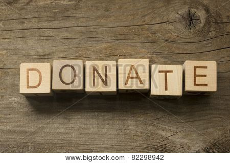 Donate text on a wooden background