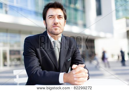 Handsome businessman sitting outdoor
