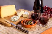 Постер, плакат: Glasses Of Red Wine And Mediterranean Appetizers