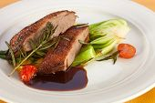 pic of roast duck  - Roasted duck breast and red wine sauce with cherry tomatoes rosemary and steamed cabbage - JPG