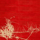 foto of vishu  - Golden shower tree blossom silhouette on red ribbed handmade paper background - JPG