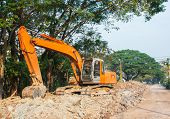 picture of backhoe  - old orange backhoe loader in road construction - JPG