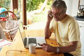 pic of card-making  - Mature Man Making On Line Purchase Using Credit Card - JPG