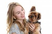 picture of yorkie  - Happy young woman holding cute small dog - JPG
