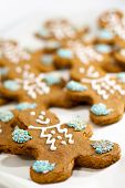 foto of gingerbread man  - closeup of fresh baked gingerbread men cookies with decorations - JPG