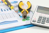 image of pliers  - Image of calculator pliers tools and business report for construction  on white desk - JPG