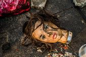 pic of hairline  - Dirty mannequin doll head was left in a garbage dump  - JPG