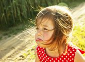 foto of cry  - Portrait of cute little kid is crying outdoors - JPG