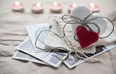 picture of ginger  - Ginger white heart shaped ginger cookie lying on the postcards for Valentine - JPG