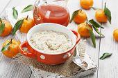 pic of mandarin orange  - Porridge in an orange bowl juice and mandarins on the table - JPG