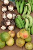 stock photo of stall  - A typical view of produce at a Caribbean Fruit stall plantains - JPG