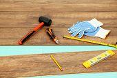 foto of laminate  - Carpenter tools on new laminate floor - JPG
