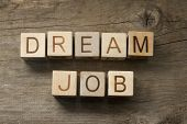image of cube  - Dream Job text on a wooden cubes on a wooden background - JPG