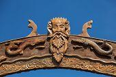 picture of poseidon  - Neptun or Poseidon face and head wooden signboard on blue background - JPG