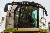 image of cabs  - Cab of combine harvester closeup on sky background - JPG
