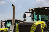 picture of cabs  - Cab of tractor closeup on sky background - JPG