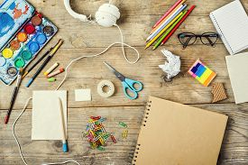 pic of shot glasses  - Desk of an artist with lots of stationery objects - JPG