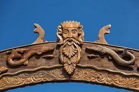 stock photo of poseidon  - Neptun or Poseidon face and head wooden signboard on blue background - JPG