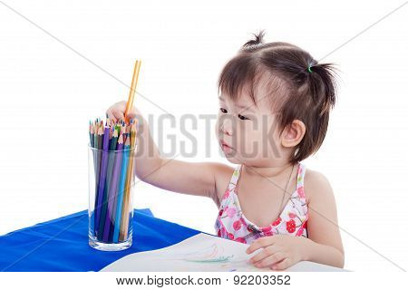 Little Girl Choosing Colour Pencil For Draw Picture