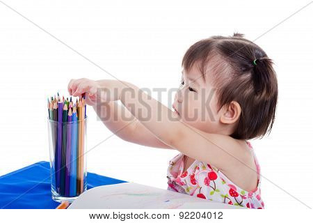 Little Girl Sitting And Choosing Colour Pencil , On White Background