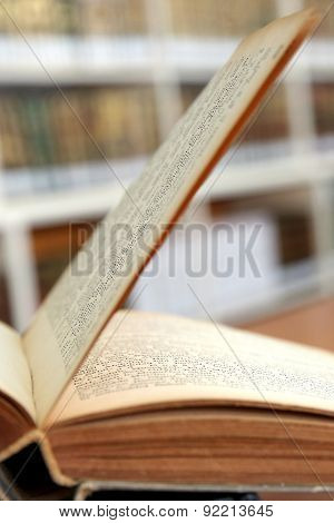 Open book in old library