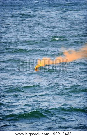 Orange Smoke Flare In The Water
