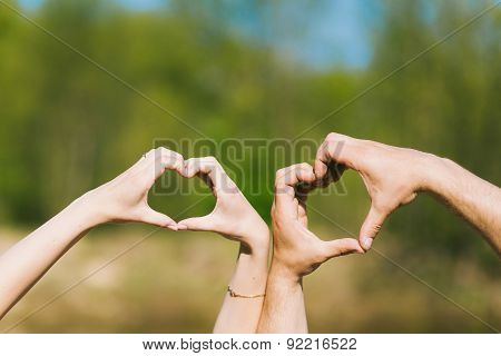 Hearts Made By Young Couples Hands