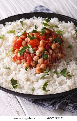 Chickpeas In Tomato Sauce With Rice In A Dish Close-up
