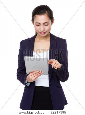 Young businesswoman use of tablet pc