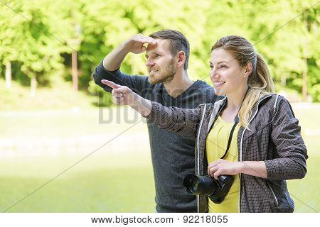 Happy Couple Tourists In Nature