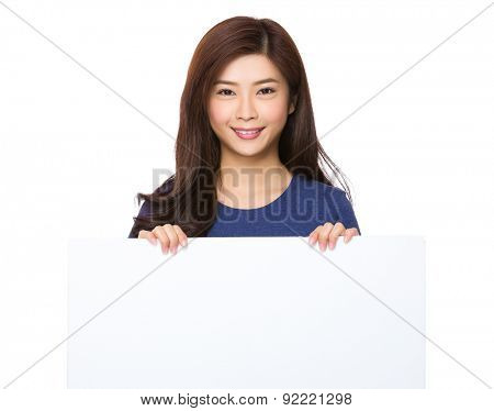 Young woman show the whte poster