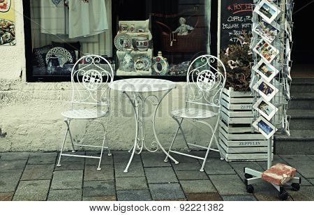 Iron Table And Chairs Near Gift And Souvenirs Shop In Old Town Of Bratislava, Slovakia.