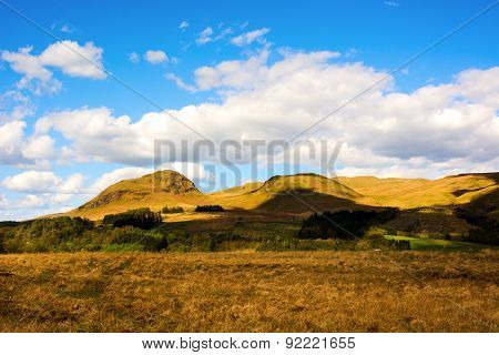 Beautiful Rural Landscape In Scottish Highlands With Field Patches, Forests, And Meadows. Beautiful