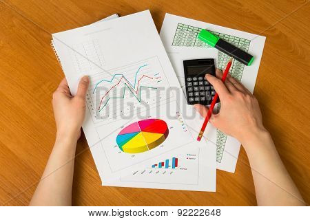 Hands over financial chart background