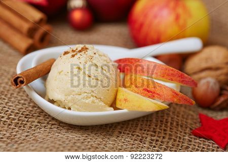 Cinnamon ice cream for christmas with apple and nuts for decoration