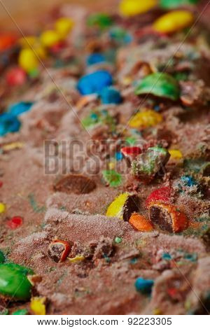 Chocolate ice cream with many chopped colored dragees