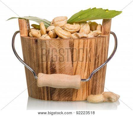 Nuts in wooden bucket
