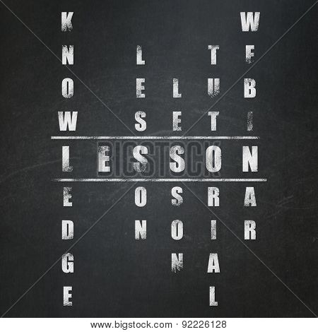 Education concept: word Lesson in solving Crossword Puzzle