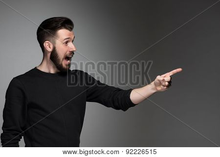 Excited man pointing a great idea - over gray background