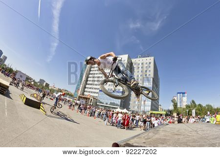 Bmx Cyclist Performs A Stunt Jump
