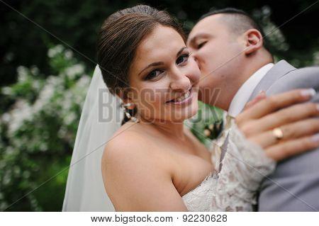 Groom Kissing His Bride Close Up