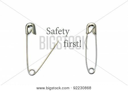Safety Pins, Open And Closed With Text Safety First