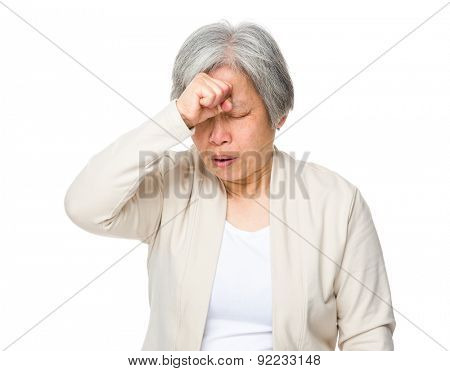 Retired woman feeling headache