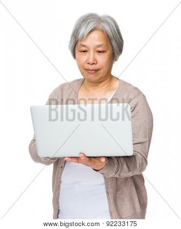 Chinese old woman use of notebook computer