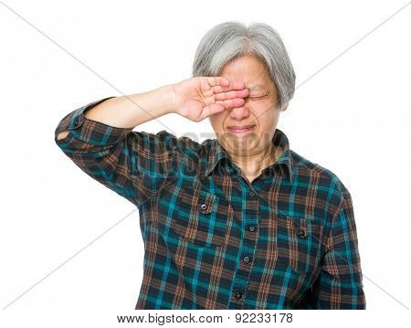 Old woman feeling eye pain