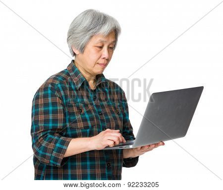 Asian mature woman use of laptop computer