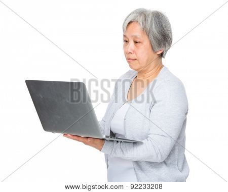 Asian old woman use of the laptop computer