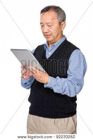 Mature man learn to use tablet
