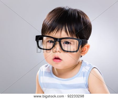 Little baby boy wear a black glasses