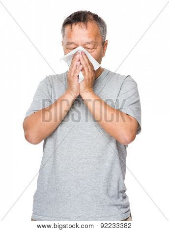 Asian old man sneeze